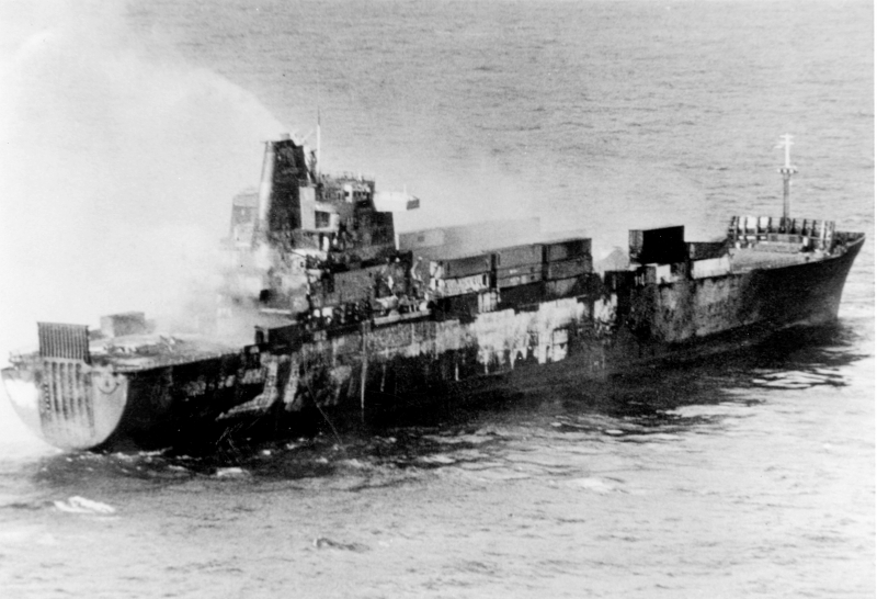 1982_05_25_Atlantic_Conveyor_burnt_out_and_sinking_after_the_Exocet_attack